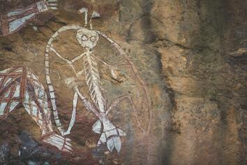 Rock art at Burrungkuy (Nourlangie) depicting Namarrgon. There is a band running between his ankles, hands and head and axes on his head, elbows and feet